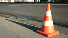 Traffic cone on asphalt surface Stock Footage