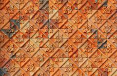 Detail of earthenware carvings wall in wat Stock Photos