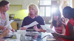 Attractive young casual business team in a meeting - stock footage