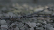 Stock Video Footage of Concentration Camp - barbed wire travelling