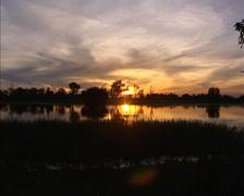 Yellow Water sunset, Kakadu National Park - wide shot Stock Footage