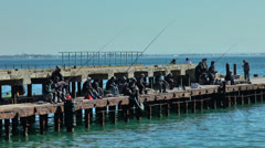 Fishermen on the pier fishing in the Black Sea Stock Footage