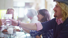 Cute young couple chatting and flirting over drinks - stock footage