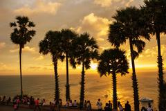 Stock Photo of palm trees at sunset on the andaman sea in thailand