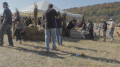 Country Farm Harvest Festival with people, tents, barbecue Stock Footage