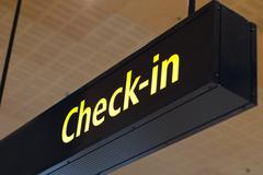 Stock Photo of check in sign