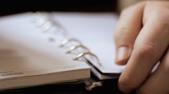 Business man writing in diary Stock Footage