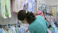 Stock Video Footage of Mother with daughter in clothes shop