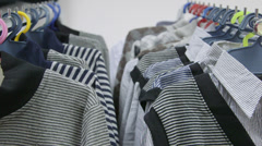 Dolly: Clothes on Hangers at Clothing Store - stock footage