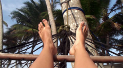 Feet girl swinging in a hammock on the beach. Maldives. - stock footage