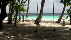View of the Maldives beach with a swing. Stock Footage