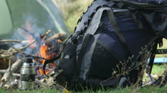 Stock Video Footage of Backpack by campfire at the camp site
