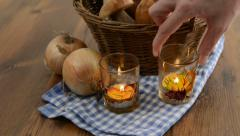Penny bun mushrooms and burning tea light candles. Stock Footage