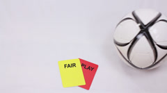 Fair Play. Soccer Penalty cards. Soccer ball stop over soccer penalty cards. - stock footage