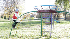 Child playing on the playground Stock Footage