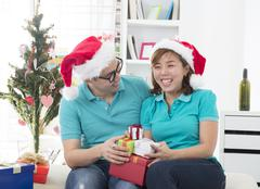 asian couple lifestyle christmas celebration gift sharing - stock photo