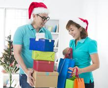 Asian couple lifestyle christmas celebration gift sharing Stock Photos