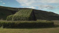 historic building of the vikings with  grass on the roof - stock footage