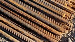 Rusty round bars completely piled construction area roadworks Stock Footage