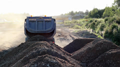 Pile of soil is being dumped by a dumptruck Stock Footage