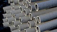 Neatly stacked large pipes Stock Footage
