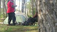 Stock Video Footage of Dolly: Couple by campfire at campsite