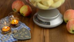 Apple pie baking. Weigh the apple on scales. Stock Footage