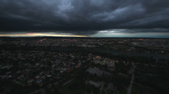 Dark clouds on the evening sky over city  Stock Footage