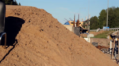 chair at the tops of heaps of soil - stock footage