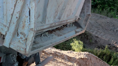 Truck full of soil and gravel unloaded Stock Footage