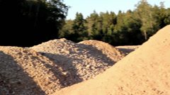Heaps of soil and a a black chair in the middle of the site Stock Footage