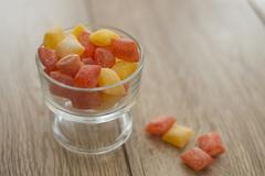 Orange and lemon bon bons in a glass bowl Stock Photos