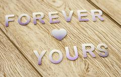 forever yours on wooden background - stock photo