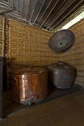 Copper distilling drums at cachaça distillery museum, pau a pique walls, bra Stock Photos