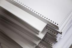 stack of white perforated paper - stock photo