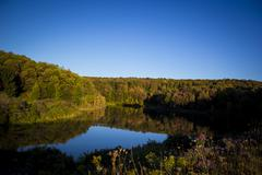 Fall Pond Reflection - stock photo