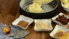 Apple pie baking. Filling cake dough in cake pan. Stock Footage