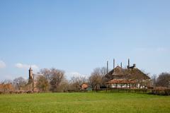 Little village in dutch landscape Stock Photos