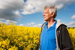 elderly man in coleseed - stock photo