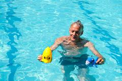 Retired man is playing Stock Photos