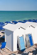 beach with sun beds - stock photo