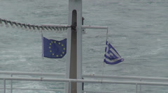 Ferry boat trail, flying flags of EU and Greece, seagulls, waveform, sea Stock Footage