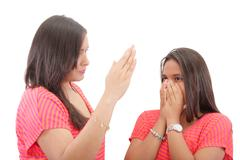 mother preparing to slap her daughter in the face - stock photo