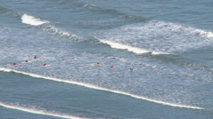 paddling out through breakers - stock footage
