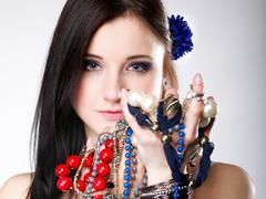 summer girl plenty of jewellery beads in hands - stock photo