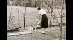 Woman and Man Gardening (1950s Archival Film) Stock Footage