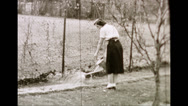 Stock Video Footage of Woman and Man Gardening (1950s Archival Film)