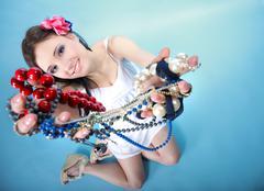 Summer girl plenty of jewellery beads in hands Stock Photos