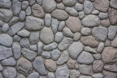 Oval stone wall Stock Photos