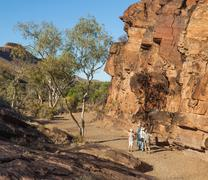 tourists at chambers gorge aboriginal engraving site. flinders ranges. south - stock photo
